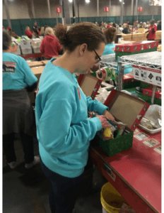 Stacey Junkin packing shoeboxes